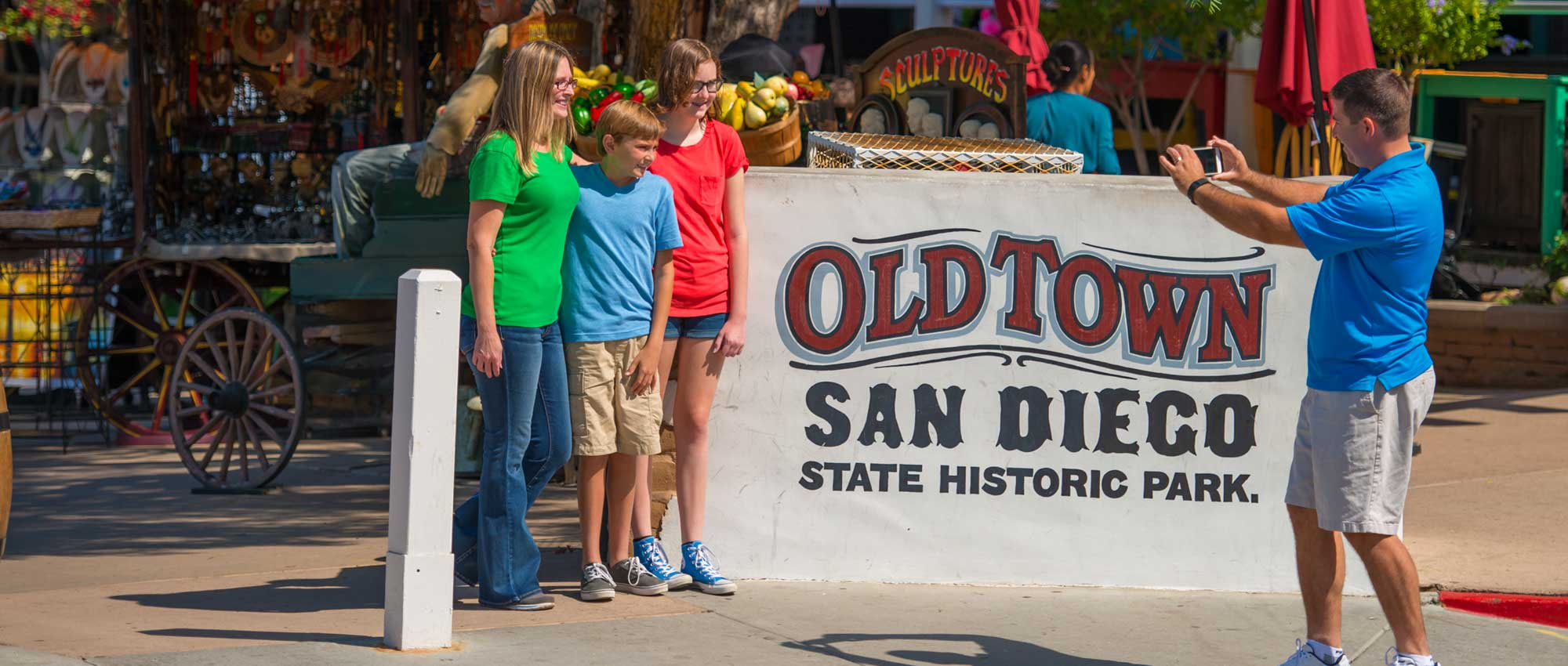 Image of people at Old Town San Diego Historic Park sign